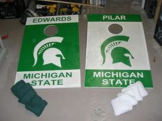 DIY - How to make a cornhole board.  Pictures of my simple yet strong cornhole game for MSU football.  Michigan State University logo and colors on the boards made of wood and removable metal pipe legs.