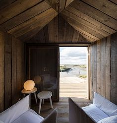 Situated on the Sado River in Portugal is a remarkably simple dwelling known as Cabanas no Rio. Designed by Manuel Aires Mateus, this home is split b. Eco Cabin, Shed Cabin, Small Space Living, Living Area, Small Spaces, Living Room, Parasols, Cabins In The Woods, Sustainable Design