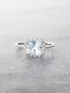 Sparkling and fancy, this gorgeous Starburst-cut Aquamarine Gem is flanked with a halo of shimmering brilliant cut Diamonds and set in stunning 14K Gold. Aquamarine measures approx. 7.5 mm x 6.5 mm, a