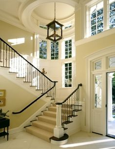 Love the staircase off to the side of the front door...as opposed to right in front of you as you enter the house