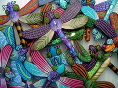 https://flic.kr/p/xuBGu | dragonflies | These are all dragonfly brooches.  All the details you see are made in the millefiori technique (canework) in polymer clay.