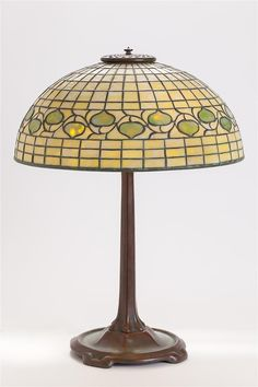 """Tiffany Studios Acorn Table Lamp  Leaded glass shade with acorn band, signed """"TIFFANY STUDIOS - NEW YORK"""", followed by """"1435"""" to interior of bottom rim; on a bronze footed standard, base marked """"TIFFANY STUDIOS - NEW YORK - 533"""" #tiffany #decarts   www.linkauctiongalleries.com Leaded Glass, Led Lamp, Acorn, Art Decor, Home Decor, Glass Shades, Tiffany, Studios, Auction"""