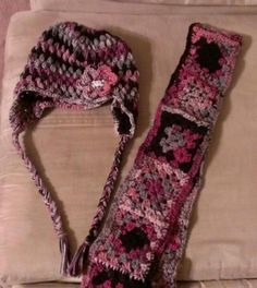 Puff stitch earflap hat and granny square scarf.
