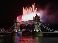 Fireworks burst over Tower Bridge and the River Thames in London during Opening Ceremonies at 2012 London Olympic games. #london2012
