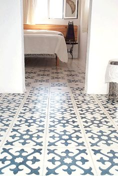 Monochromatic blue and white patterned cement tile for the floor.