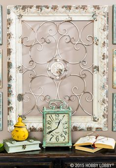 Add visual interest to your walls for spring with a grouping of metal wall decor!