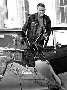 Steve McQueen getting into his 1966 Corvette Stingray.