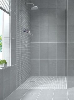 http://walkinshowers.org/6-incredible-rainfall-shower-head-examples.html ~ Create a modern looking bathroom by mixing different shapes of floor tiles, walls tiles & mosaic bathroom tiles in the same colour. Shown here: Zeus Mate Cinza