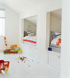 cubbie beds. White kidsroom, but still so colorful