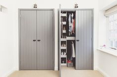 A grey colour scheme bedroom makeover with french and industrial styling | Bespoke wardrobes painted in Plummett by Farrow & Ball