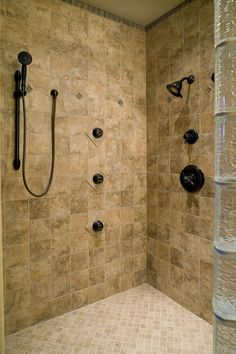 You couldn't ask for more shower outlets than this remodeled beauty. They could go without the glass block entry. #showerpanels #glassblocks