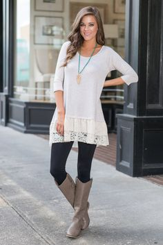 We hope we have your full attention! Because you are going to want to see this top! It totally hits the mark on being comfy and cute!! The soft oatmeal color makes it so easy to style! You can pair it with skinny jeans or black or brown leggings! Plus, that ruffled sheer and lace fabric hemline is adorable!