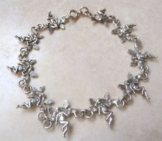 Sterling silver fantasy fairy link bracelet The bracelet is formed from ten small individual fairies linked together The bracelet has a spring ring