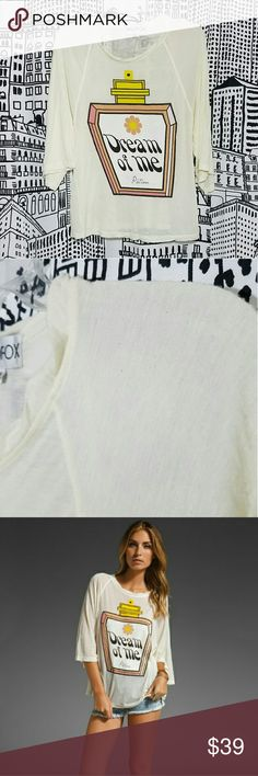 """WILDFOX Dream Potion Oversized Raglan Tee Details - Scoop neck - 3/4 length raglan sleeves - Front graphic print - Sharkbite hem - Oversize fit - Approx. 26"""" shortest length, 28"""" longest length - Made in USA Fiber Content 100% cotton Care Machine wash cold Wildfox Tops"""