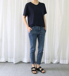 Casual cropped mom jeans, blue denim, black Birkenstocks, loose navy tee