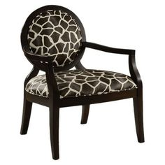 Give classic design a contemporary twist with this chic accent chair, showcasing geometric-print upholstery and tapered wood legs.    P...