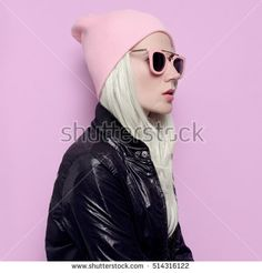Glamorous blonde in fashionable hat beanie and pink glasses Vanilla vibration