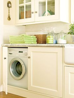 Laundry room...like hidden washer and dryer and jars on top