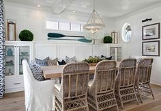 Beach House with Inspiring Coastal Interiors. This chic coastal dining room features a turquoise beaded chandelier.