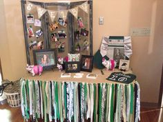 Senior Table - the skirt is strips of fabric looped onto a piece of jute twine and the tri-fold display are old window screens hinged together with a name banner made out of burlap.