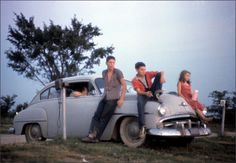 Family watching a movie at a drive in theater between Flora and Louisville Illinois, 1960 Photo: Wayne Miller