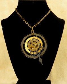 Steampunk Clock Gear Necklace by CodachromeCreations on Etsy  Handmade item Cost: $50 usd Length: 20 - 28 inches Materials: Vintage clock parts, Screws and nuts, Jump rings Ships worldwide from Thousand Oaks, California