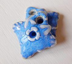 Porcelain ,blue earrings . By Mª Carmen Rodriguez ( Majoyoal ) https://www.facebook.com/groups/CeramicArtBeadMarket