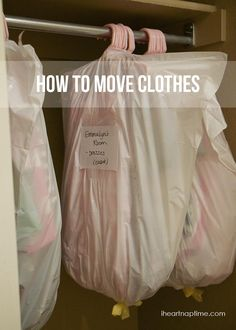 """packing"" clothes for a move, still on the hanger, in a garbage bag!"
