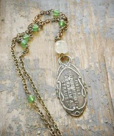 lost & found necklace. antique return tag, distressed faux pearl, green jade on oxidized sterling silver. ooak vintage assemblage by val b.. $49.00, via Etsy.