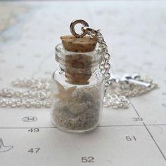 Beach bottled treasure necklace Find beach bottles, mini glass bottles, beach glass. charms, pearls & chains at www.eCrafty.com #ecrafty #beachbottlenecklace #diycrafts