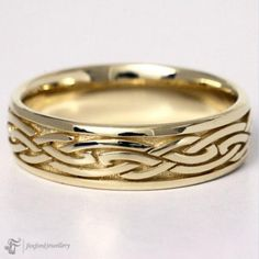 Celtic Wedding ring custom made to order by Foxford Jewellery. This ring is wide with raised celtic pattern flowing all the way around the finger, it is slightly rounded on inside of the band for extreme comfort during wear. Silver Celtic Rings, Silver Claddagh Ring, Claddagh Rings, Irish Wedding Rings, Wedding Bands, Celtic Patterns, Irish Jewelry, Irish Celtic, Jewelry Shop