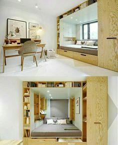 Кровать-подиум под окном с полками и нишами для хранения