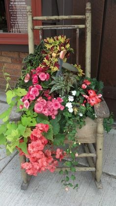 Old rocking chair turned planter i saw while road tripping through northern wisco! Looks like they cut a hole in the burlap seat filled it with dirt and planted! Gorgeous!