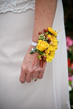Corsage Types | eHow - * Clothing Attached Corsage: pin or magnet; * Wrist Corsage; * Attach the corsage to your purse; * A fairly new trend in corsages is the hand-held corsage. Smaller than a bouquet, yet extremely similar in design, smaller sized flowers are used to create the design. The corsage is then wrapped with ribbons and carried in one hand.