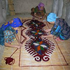 The images have been taken in 2008 in Turkmenistan showing one of the oldest procedures on how to make felt rugs with moisture, heat, friction by wrapping the wool like if it was sushi and striking it repeatedly.
