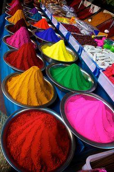 Piles of colorful bindi powder brighten a market in Mysore, India