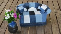 Old Jeans Mini Sofa - Learn how to make a teeny tiny couch to hide an unsightly tissue box when you create this adorable, upcycled sewing project. This eccentric little piece of DIY home decor is designed to use up old scraps from jeans and other clothing you no longer wear. The Old Jeans Mini Sofa will take you several hours to make, requires just under a yard of fabric scraps, and is sure to impress your friends. Consider combining this and other scrap fabric projects to create a unique…