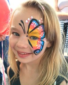 A half face butterfly design face painted from our face painter Niloo.