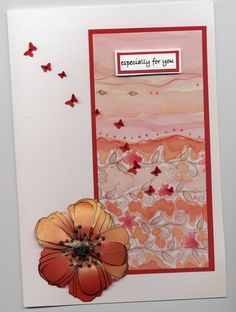 Mother's Day card 2007.  Made on workshop. Flower stamped on velum and cut out 3 times.  Centre is black diamond glitter glue.  Butterflies cut out and placed on at random with glitter glue in centre.