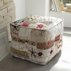 patchwork ottoman....love this but it would have to tucked away in a quiet room where it would b safe :-)