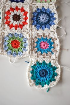 I've been hooked on granny squares lately... great free pattern and how-to for a blanket!