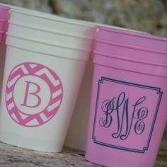 White cup with Hot Pink ink using B-16 border and Wavy font for the B. Soft Pink Cup with F-38 border and M-25-B Ornate monogram in Dark Grey ink.