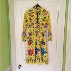 """60s 70s psychedelic flower dot Maurice dress, S Beautiful vintage Maurice yellow dress, in good vintage condition with some light spotting in several places, measured shoulder to shoulder: 17"""" flat, waist 13"""" flat; the hem has also been lengthened by hand and a blue ribbon put in to replicate the stripe border. This has a mandarin collar with button and zip front (concealed) closure, and is gorgeously patterned with flowers, dots, and the occasional classic 'Maurice' signature. Feel free to…"""