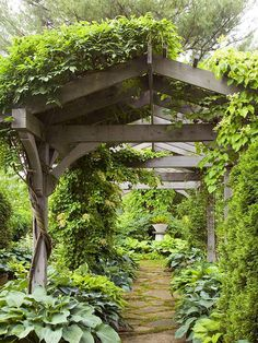 A rustic pergola makes this garden a dreamy getaway. Add a pergola to your yard with our tips: http://www.bhg.com/home-improvement/outdoor/pergola-arbor-trellis/add-interest-with-a-pergola/?socsrc=bhgpin071712vinecoveredpergola#page=2