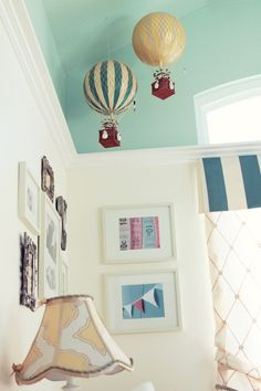 The hot air balloons add such a fun, whimsical touch to this nursery!