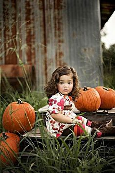 Kid and pumpkins