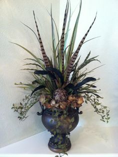 Tall Grass & Feather Arrangement in bronze urn by Greatwood Floral Designs.