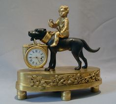 Whimsical French Empire small size dog clock with child. at Gavin Douglas Fine Antiques Ltd. in London, specialists in antique clocks and decorative gilt bronze Antique Mantle Clock, Antique Desk, Antique Clocks, Vintage Clocks, Vintage Dog, Vintage Walls, French Vintage, French Clock, Clever Dog