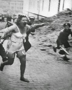 One of the most intimate of horrible pictures from the era of a Jewish woman being chased by Ukrainian kids and German soldiers in Lvov.