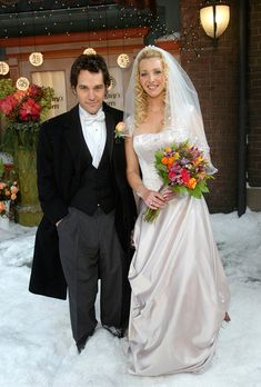 """Love the happy bouquet! Brides.com: . Phoebe on Friends. The last of the bunch to say """"I do,"""" the hilariously eccentric Phoebe wore an unexpectedly traditional dress for her snowy ceremony outside Central Perk to Mike Hannigan (played by a young and handsome Paul Rudd)."""